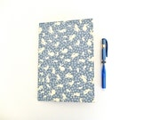 """A big size notebook (5.9"""" x 8.3""""), covered by me with a Japanese paper, blue with white rabbits. Very cute !"""