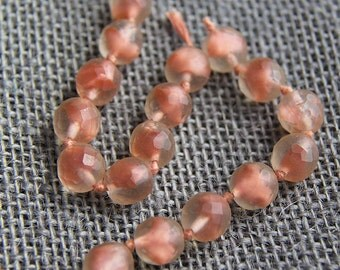 Vintage 1950's Glass Beads on a Knotted Strand Clear with Pink Inset