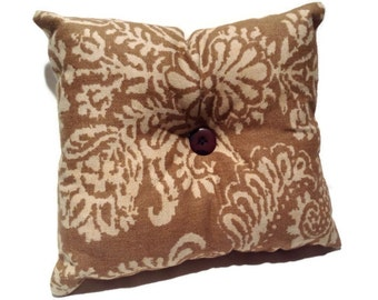 Decorative tan throw pillow, floral, home decor, accent pillows