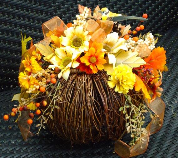 Fall floral arrangement on natural twig pumpkin