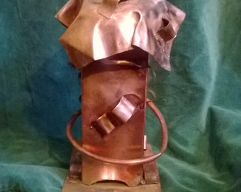 Handcrafted copper birdfeeder