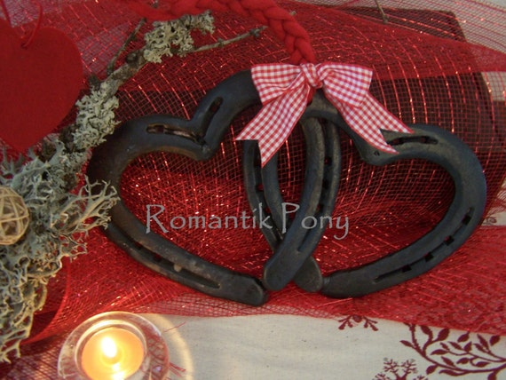 Twisted Hearts handmade with  horseshoes, hot forged at heart