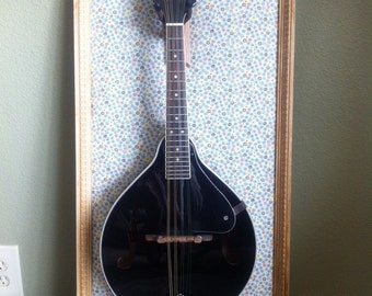 """Wall mounting instrument hanger. This size is meant for mandolins. I call it a""""Sheila Frame""""."""