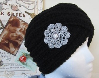 Turban Twist fashionable hat hand made for that smart office look or on company travel - Black, Silver  Flower Motif  & ctr. pearl button