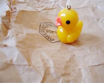 2pcs Lovely  Resin Smiling little yellow duck pendants.
