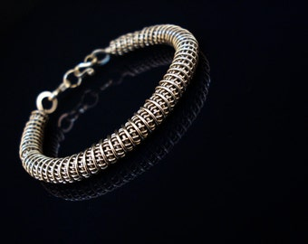 Handcrafted alpacca wire coil bracelet perfect for both men and women
