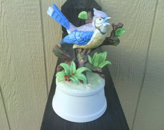 "VTG Music Box with a Blue Bird  Sitting on a Limb,  ""Laura's Theme""."