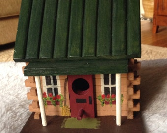 Hand painted log cabin birdhouse.