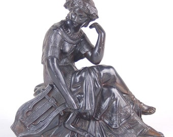 Spelter sculpture of some hot babe in a diaphanous gown with hand harp