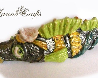 Ceramic home decoration, fish, gree, orange, black.