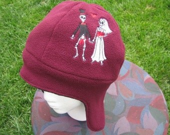 Dia de Los Muertos Skeleton Couple Maroon and Black Fleece Ear Flap Hat