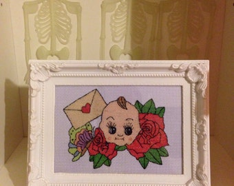 Kewpie doll cross stitch