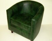 Tub Chair Upholstered In A Green Faux Leather With Mahogany Wood Legs