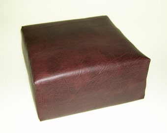 Booster seat cushion made with firm foam and upholstered in dark brown faux leather