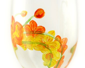Hand painted orange and yellow orchids wine glass