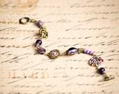 Purple, lilac and antique gold Maasai beadwork bracelet