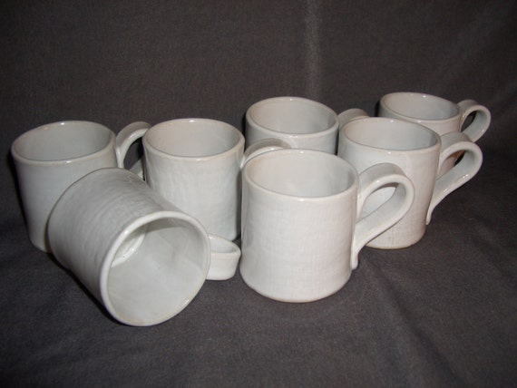Swedish handmade small white potterycups .