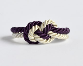 Deep purple and natural beige infinity knot nautical rope bracelet with silver anchor charm