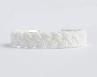 Matte white braided nautical rope bracelet with silver anchor charm
