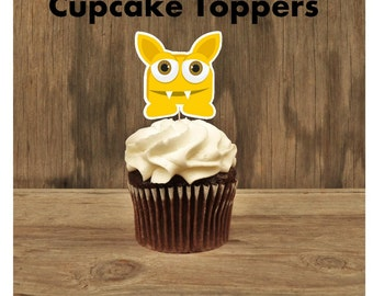 Little Monsters Party - Set of 12 Yellow Monster Cupcake Toppers by The Birthday House