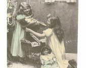 EDWARDIAN GIRLS  Playing w/ Their New PoRCELAIN DOLLS by the ChRISTMAS Tree - PaSTLE Hand Tinted Real PhOTO Postcard