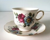 Queen Anne Bone China Tea Cup and Saucer England Numbered Red, Blue and White Flowers