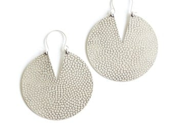 "Bold and round silver earrings with hammered texture and visually contrasting V shaped cutout, a unique hassle-free design - ""Iya Earrings"""
