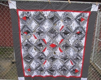 Black and White quilt top with a splash of red