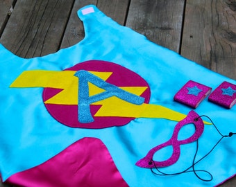 Girls SUPERHERO 3 piece costume - Includes personalized cape - sparkle superhero mask - and set of sparkle wrist bands