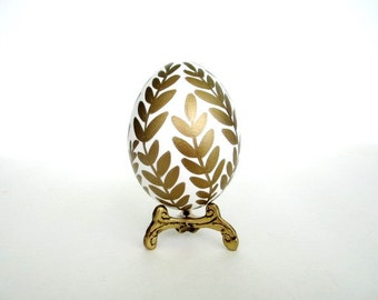 Golden egg ornament on real chicken egg shell make a unique home decor