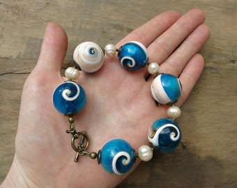 Blue Shell Statement Bracelet, chunky nautilus spiral and pearl Bohemian beach jewelry, blue and white seashell bracelet