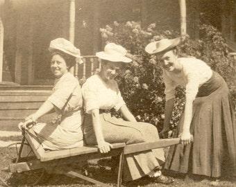 Three GIRLFRIENDS PLAYING Around on a WHEELBARROW In Fun Photo Postcard Circa 1908