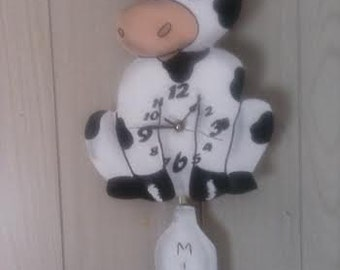 Kitchen cow pendulum clock with swing milk bottle