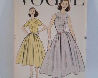 Vintage Vogue 1950s sleeveless and short sleeve full skirt dress with yoke women's pretty sewing pattern