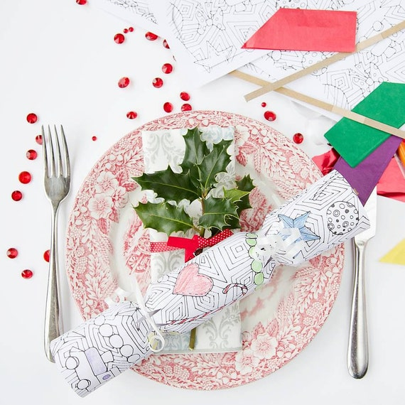 Colouring-In Christmas Cracker Kit. Pack of 6, can be personalised. Includes snap, tags, ribbon, party hats & jokes.