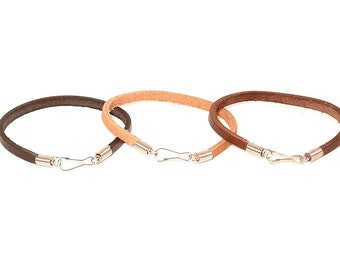 Plain leather bracelet with steel spring tips and carabiner or lobster clasp.