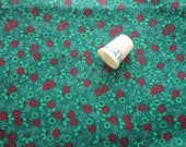 tiny red pointsettias on green christmas print cotton fabric -- 45 wide by 2 yards plus