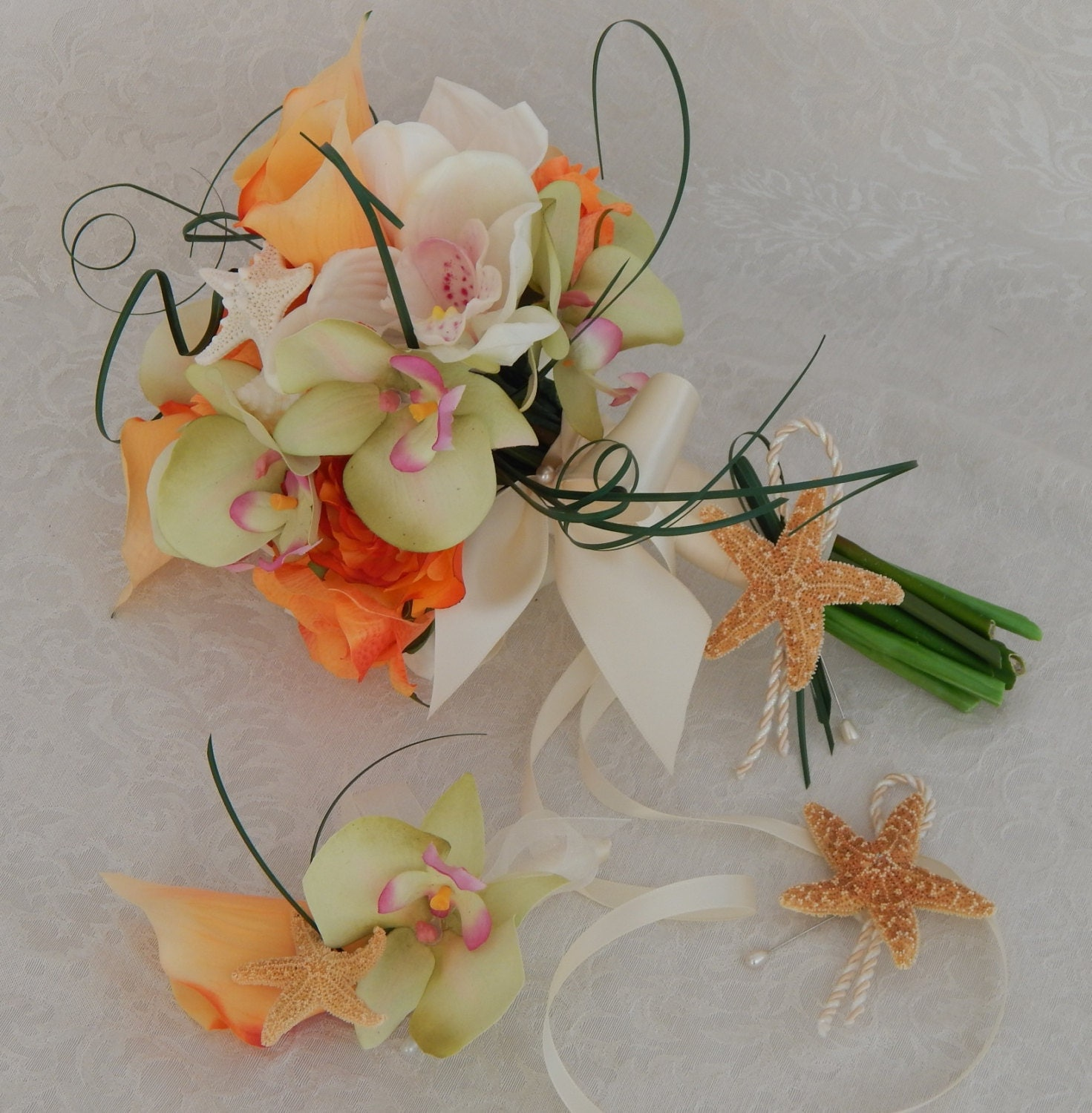 Beach wedding bouquet orchid calla lily rose starfish and