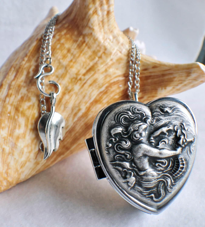 Music box locket heart shaped locket with by ...