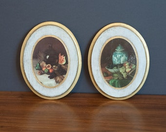 Pair of oval Florentine still life plaques, Italian Florentine wall hangings, pair of gilded wall plaques