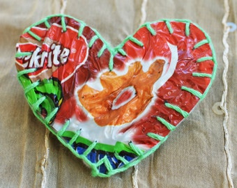 Valentine love heart brooch handmade from recycled plastic crisp packets. Unique, textural, red, green, embroidered cotton, unusual, gift