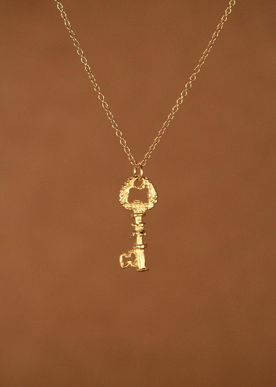 key necklace gold key necklace a tiny 22k gold overlay