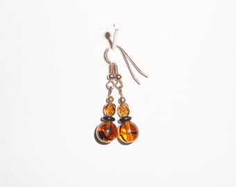 Vintage pierced earrings in root beer, jet and amber glass beaded dangle earrings 1970s jewelry