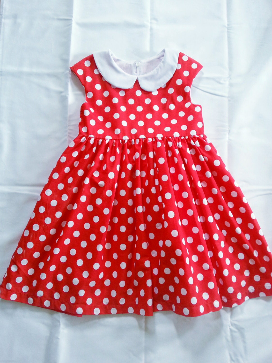 Disney Minnie Mouse Clothing. Clothing. Product - Minnie Mouse LIttle Girls' X Polka Dot One-Piece Swimsuit. Clearance. Product Image. Price Disney Little Girls' Minnie Mouse Allover Print Knit Dress, Hot Pink (4) See Details. Product - Girls Minnie Mouse Bi-Fold Wallet Pink.