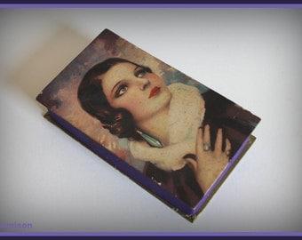 Thirties / twenties vintage art deco  cardboard gift box with flapper girl portrait.