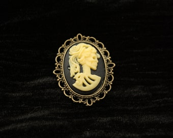 Yellow Skeleton Lady Cameo set in Bronze Filigree Brooch