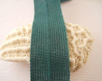 "TRIM:  Cotton fold-over ""braid"", green, 1 inch wide.  1 yard."