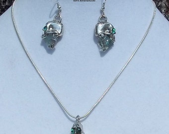 """Skulls Necklace and Earrings made with """"It's a Mad, Mad, Mad, Mad World"""" car glass"""