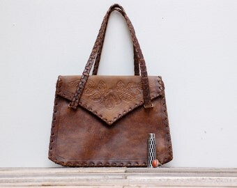 French vintage brown leather bag decorated with a rose