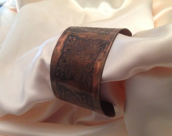 copper cuff with etched symbols
